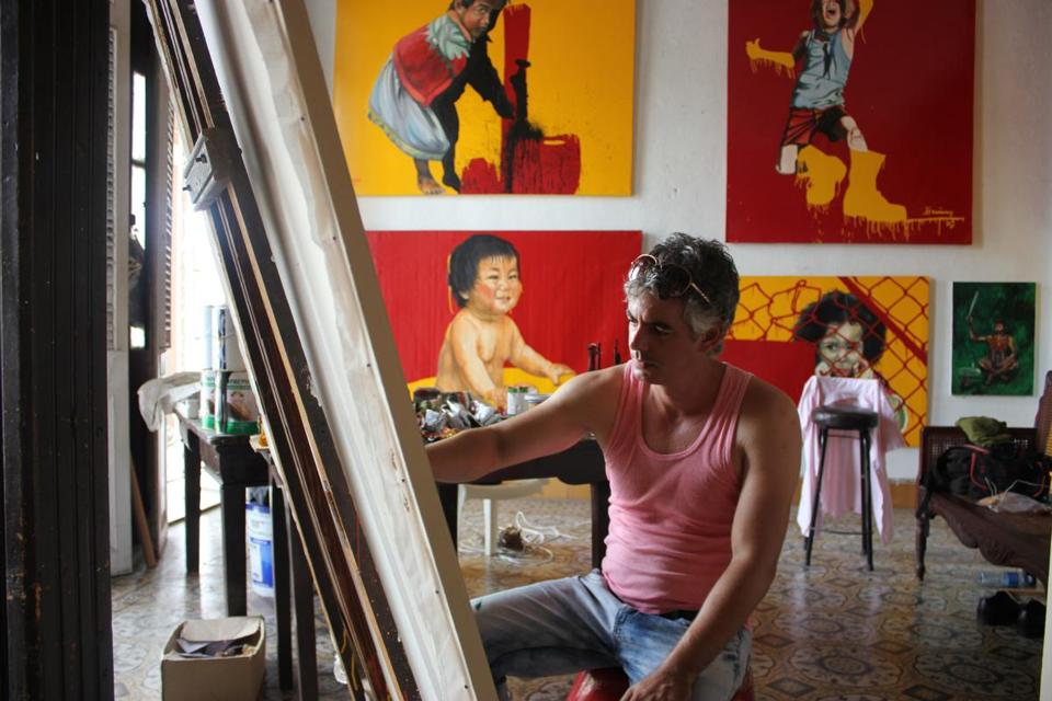 An artist at work in his studio in Cienfuegos, Cuba.